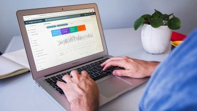 Person viewing Google Search Console on a Macbook Air laptop