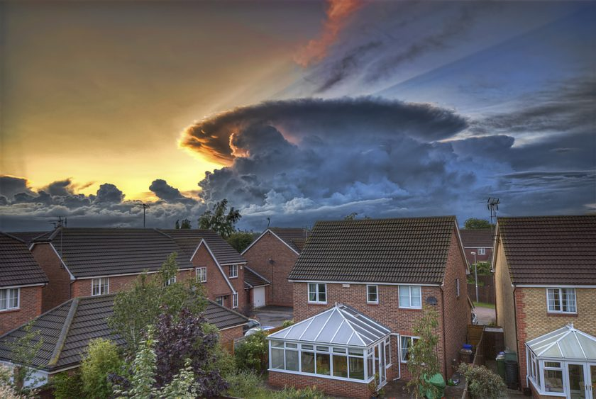 A massive cumulonimbus in the distance. Awesome picture. Photo via Matador Network.