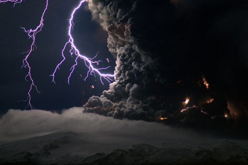 "Volcano lightning, or ""dirty thunderstorms,"" occur when volcanic ash, ice particles, and rocks collide in a volcanic plume, causing static and, eventually, lightning. This photo was taken during the 2010 eruption of the Icelandic volcano Eyjafjallajökull. Photo via Volcano World."