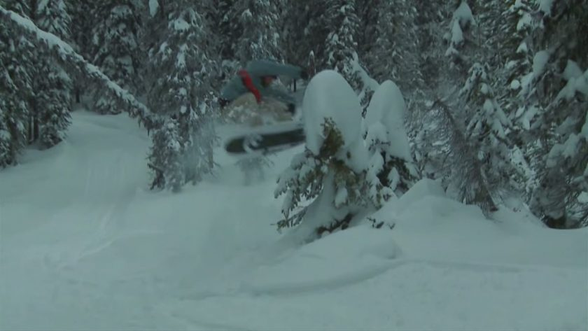 Kicking off a tree in the backcountry. Photo is a screen grab from video.
