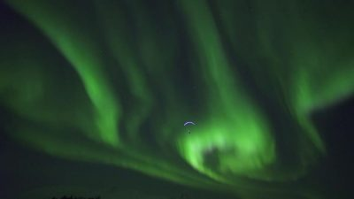 Surfing the Aurora Borealis with a Paraglider