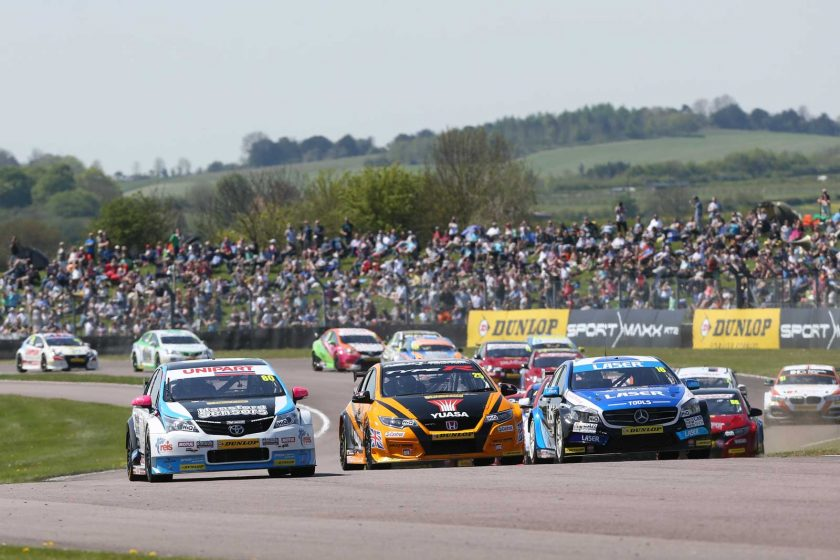 The action started three wide in front of a huge crowd. Photo: BTCC