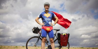 Meet the man cycling across all 7 continents dressed as superman