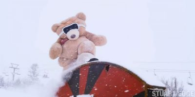 Giant teddy bear carves down Utah's mountains on a snowboard
