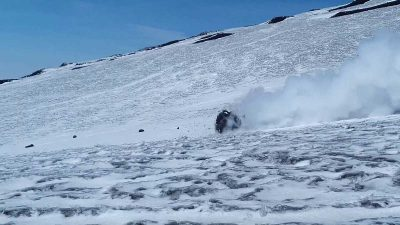 Skiers narrowly avoid lava boulder crashing down the slopes of Mt. Etna