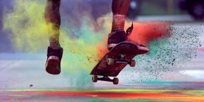 Slow motion film captures the beauty of exploding colour and skateboarding