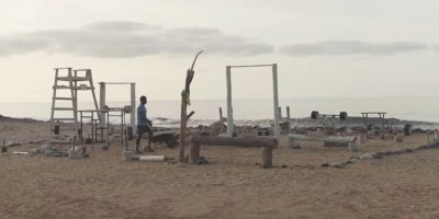 A man creates a gym out of beach rubbish on his home island