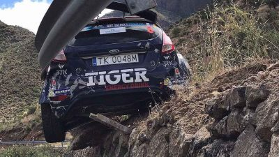 Guardrail saves rally driver from tumbling off cliff