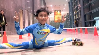 Eight year old schoolboy sets new world record for limbo skating under bars