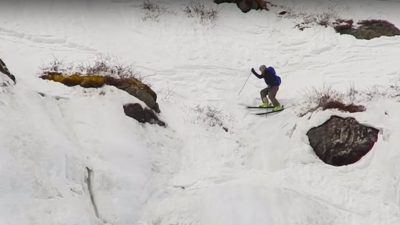 Skier commits to super steep slope but trips at the last moment
