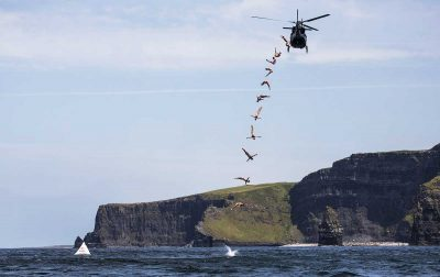 High divers launch from helicopter over Cliffs of Moher for incredible photo shoot