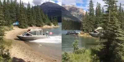 16 foot jet boat heads full speed at shore line to pull off an epic land-based stunt