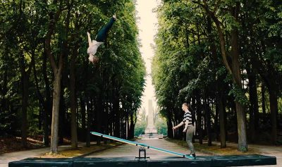 Acrobatic duo pulls off amazing flips using just a plank of wood