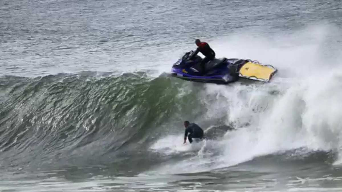 Jet ski driver narrowly avoids landing on surfer as he's carried 'over the falls'