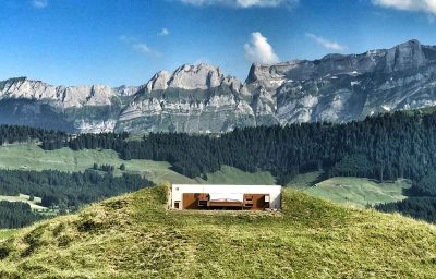 This wall-less hotel offers panoramic views of the Swiss mountains