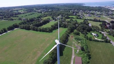 Drone captures man sunbathing on top of a 200 ft wind turbine