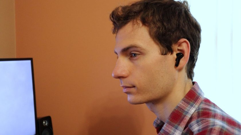 Me listening to music with the Zendure ZenPods fitted comfortably in my ear.