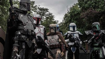 Group of people dressed in Star Wars Mandalorian cosplay constumes