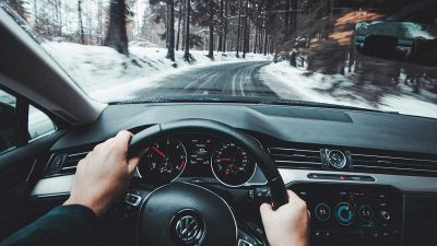 Person driving car in winter conditions