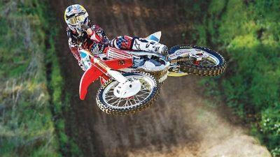 Ashley Fiolek jumping a dirt bike