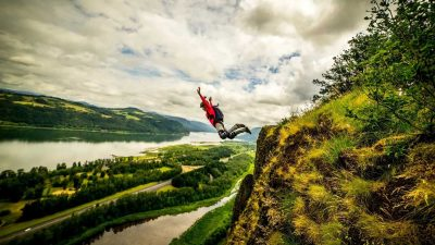 Clair Marie base jumping off a cliff