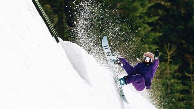 Jamie Anderson snowboarding on a halfpipe