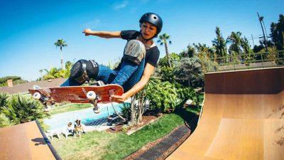 Lizzie Armanto skateboarding on a halfpipe