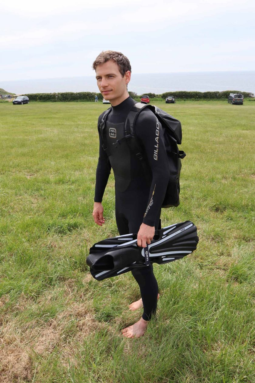 Carrying the DryTide 50L waterproof backpack over a wetsuit