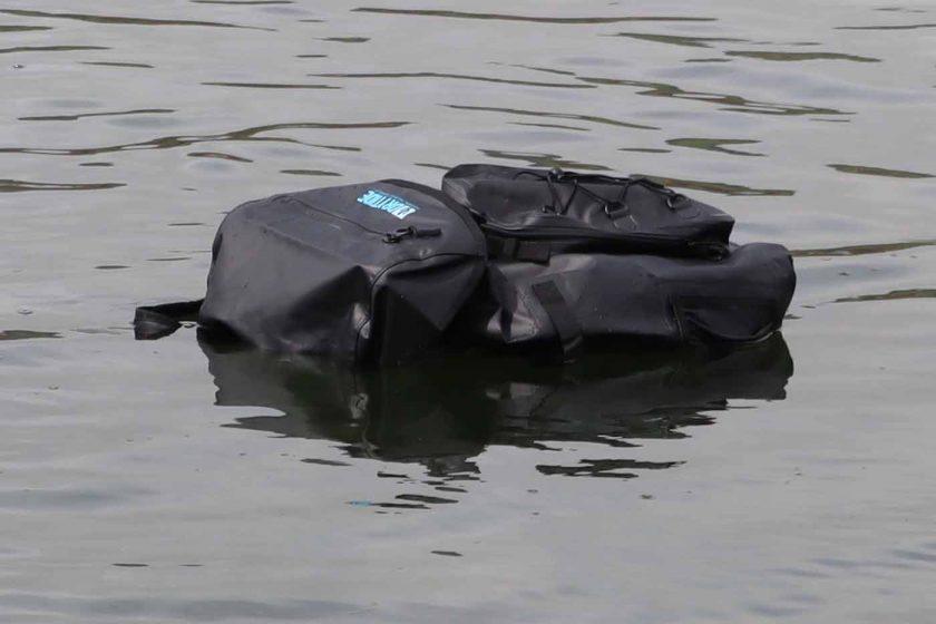 DryTide 50L waterproof backpack floating on the ocean surface
