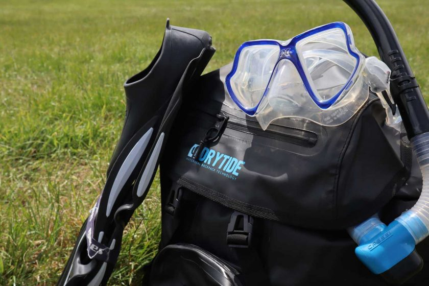 Top pocket of the DryTide 50L waterproof backpack featuring a rainproof zipper