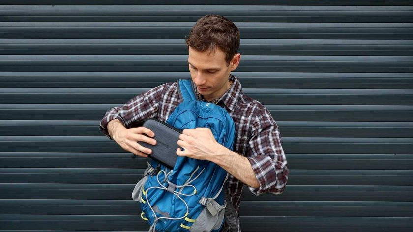 Packing the tech organiser into a backpack pocket
