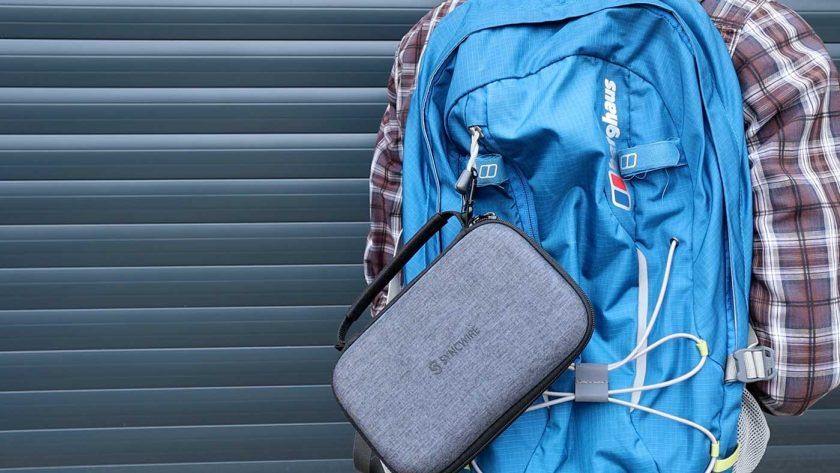 The Syncwire travel case attached to the outside of a backpack