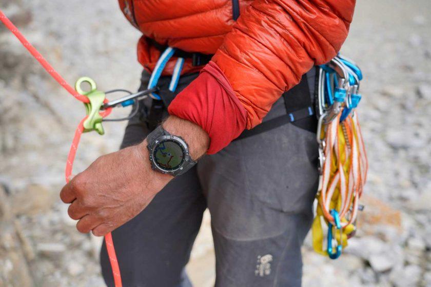 Rock climber belaying while wearing the COROS VERTIX 2 GPS adventure watch