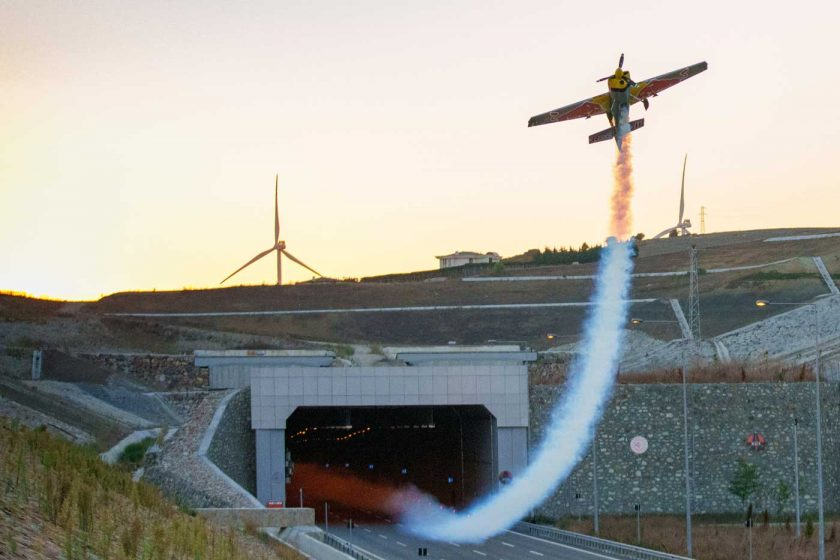 Dario Costa pulling up into a celebratory loop after successfully piloting an aeroplane through a tunnel