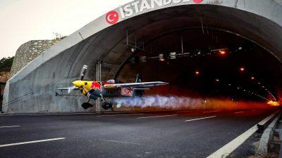 Dario Costa piloting an aeroplane through a tunnel