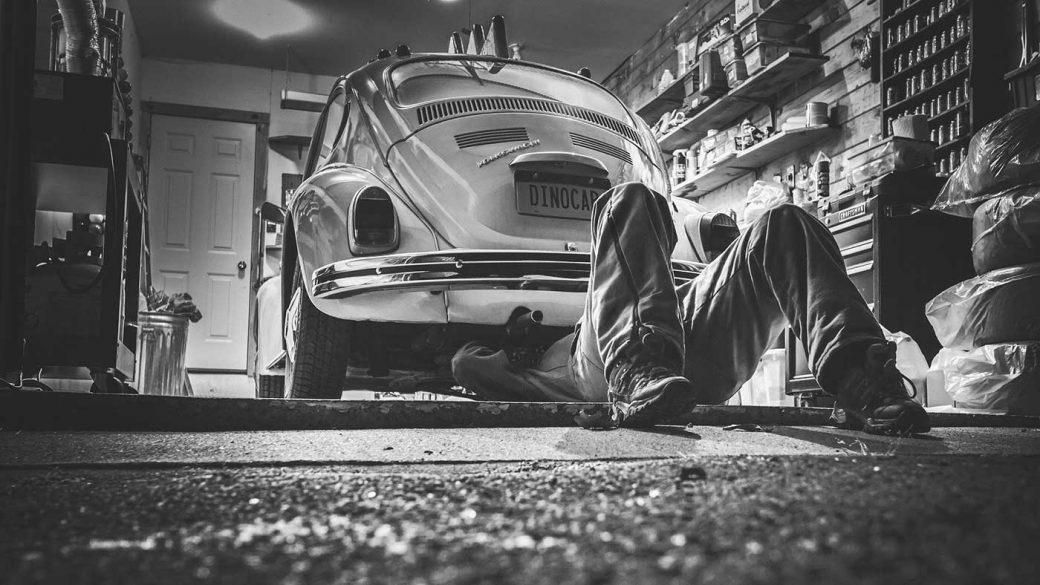 Car mechanic repairing a Volkswagen Beetle
