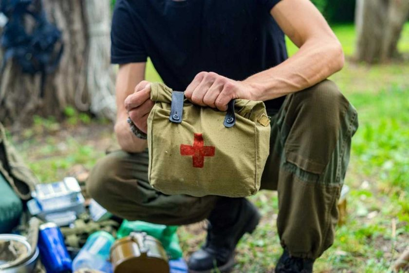 A man holding a travel first aid kit