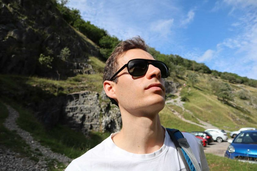 Looking at a rock climbing route in Cheddar through the Vallon Howlin' sunglasses