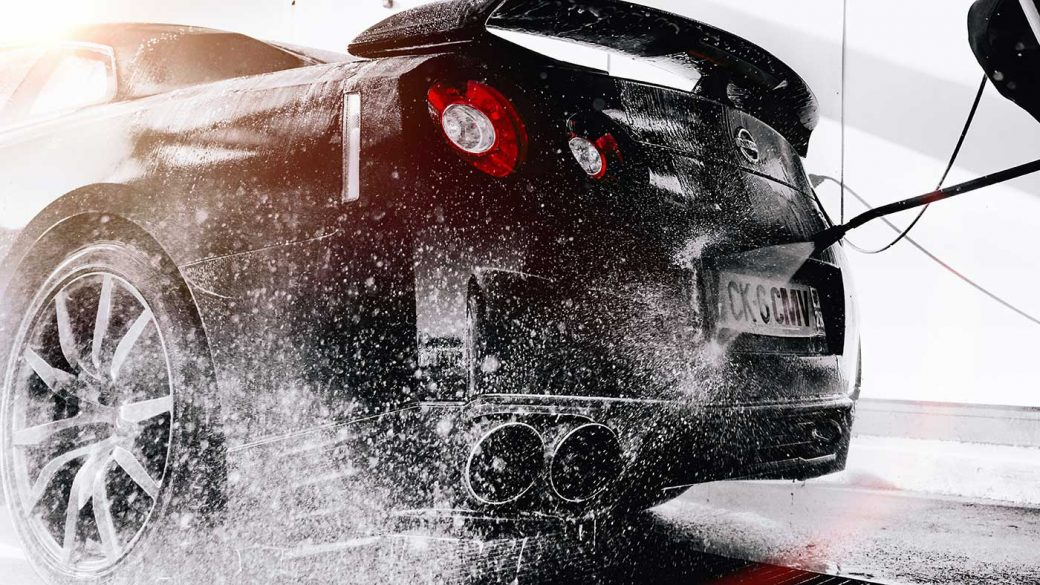Car being washed using a pressure washer