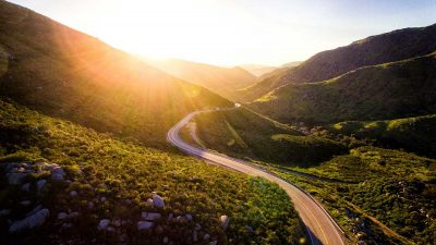 Winding road extending into the sunset